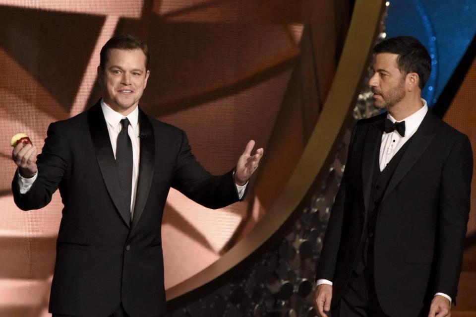 Actor Matt Damon (left)  and host Jimmy Kimmel spoke onstage during the 68th Emmy Awards in 2016 at the Microsoft Theatre in Los Angeles.